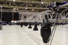 Installation Of Professional Sound, Light, Video And Stage Equipment For A Concert. Stage Lighting Equipment Is Clamped On A Truss For Lifting.