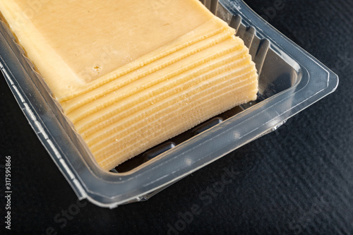 Photo Slices of yellow cheese in a plastic package