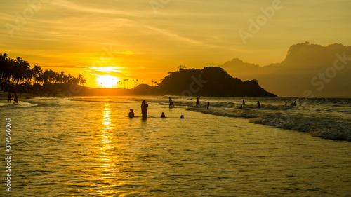 Beautiful fiery sunset on Nacpan beach, Palawan, Philippines #317596078