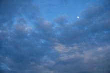 Landscape Of Sky Is Covered With Darkness With Beautiful Moon Shining Far Away.