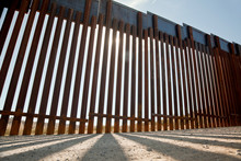 Ground Level View Of Border Fence/Wall.