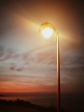 Vertical Shot Of A Bright Lamp...