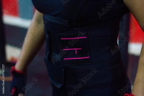 Fotografia, Obraz Mujer con faja deportiva color negro.