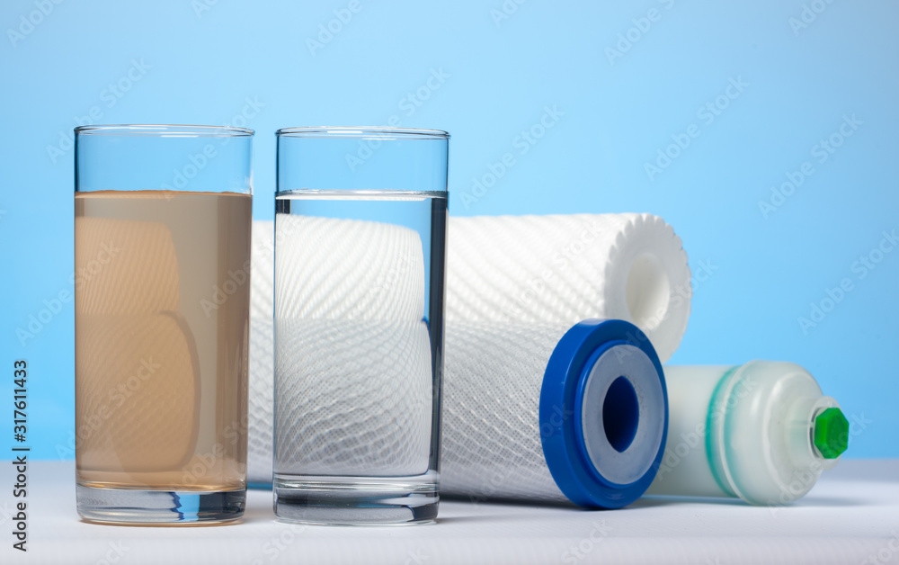Fototapeta Glasses of dirty and clear water and filter cartridges
