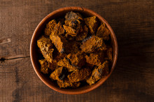 Bowl With Chaga Mushroom. Medicinal Drink With Pieces Of Chaga