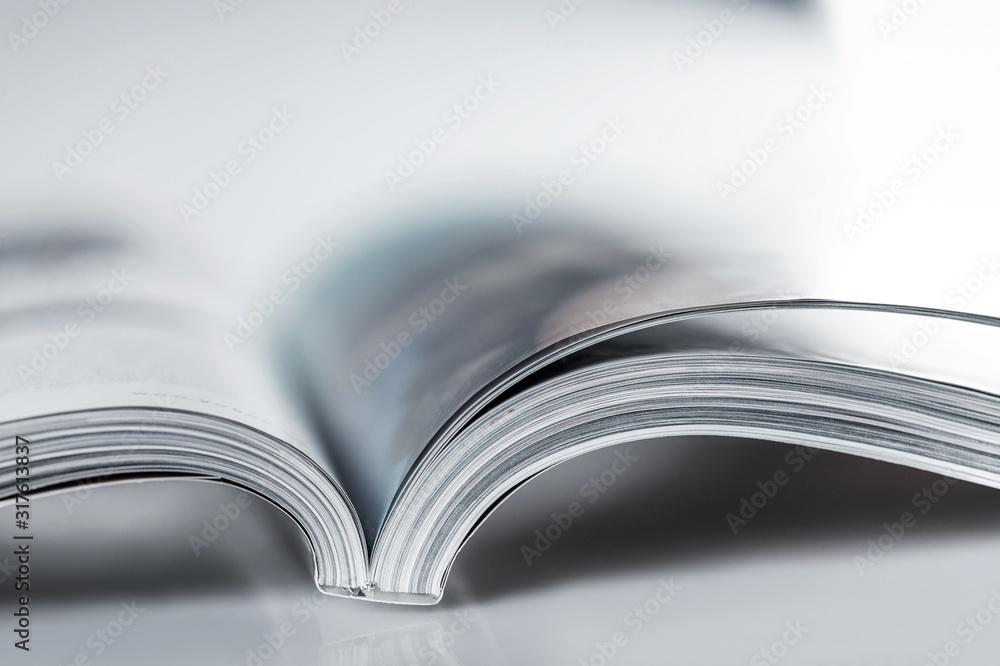 Fototapeta Pile of Open magazines, blue toned image