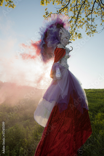 Photo Fairy tale woman on stilts in bright fantasy stylization.
