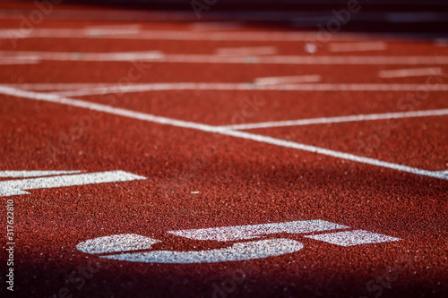 Fotografía Red running sport track background and texture