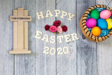 Cross, Flowers, Easter Eggs, On A Wood Background With Happy Easter 2020
