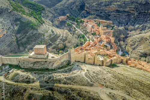 Aerial view of the medieval walls and towers surrounding Albarracin, voted the most beautiful village in Spain