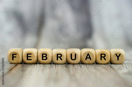 Obraz The word February on wooden cubes. Month of year - fototapety do salonu