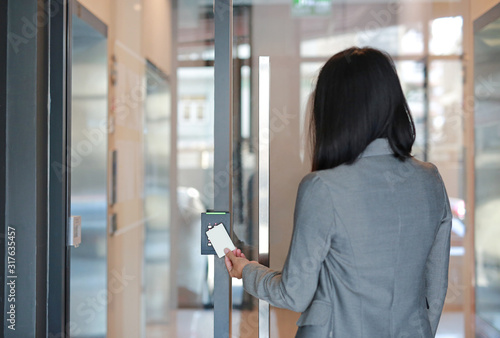 Young officer woman holding a key card to lock and unlock door for access entry Canvas Print