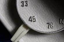 Macro Close Up Photograph Of 33, 45 Or 78 Rpm Selector Switch On Vintage Record Player Turntable.
