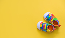 Shoes For Newborns On A Yellow Background. Selective Focus.