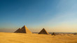 Great Cheops Pyramid and the smaller pyramids with downtown Cairo in the background
