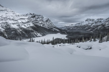 Winter In Peyto Lake In Mistaya Valley Against Caldron Peak And Mount Patterson, Bow Summit, Banff National Park, Alberta, Canada