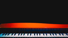 Red Grand Piano, Isolated On Black. Music Background