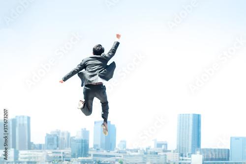 Photo ジャンプするビジネスマン