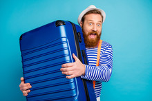 Amazed Excited Cheerful Man Fun Summer Tourist Voyage Weekend Arrive Hotel Crarry Big Luggage Wear White Headwear Sunhat Orange Suspenders Vest Isolated Over Blue Color Background