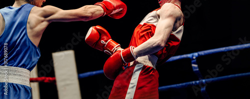 boxing match in ring boxer lands right jab to opponent Canvas Print