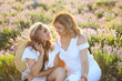 canvas print picture Middle age woman with her adult daughter in sunset light