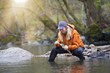 woman fly fishing catching rainbow trout