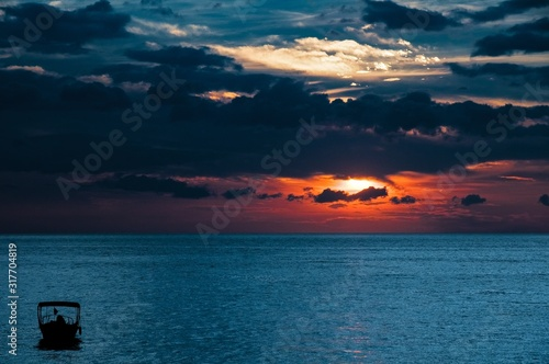 beautiful-shot-of-a-sunrise-in-the-ocean-with-a-cloudy-sky