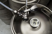 Top View Of A Keg With A Detached Coupler And Pipes