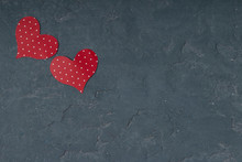 Two Red Hearts On Concrete Bac...