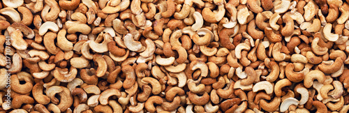 Fotografía Cashew nuts peeled full background. Panorama. Banner.