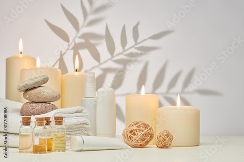 Fototapety, obrazy: Spa still life with creams, essential oils, candles on light background. Healthy lifestyle, body care, Spa treatment