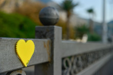 Yellow Heart On A Fence