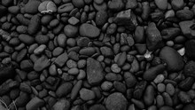 Black Stones Background. Pebbl...