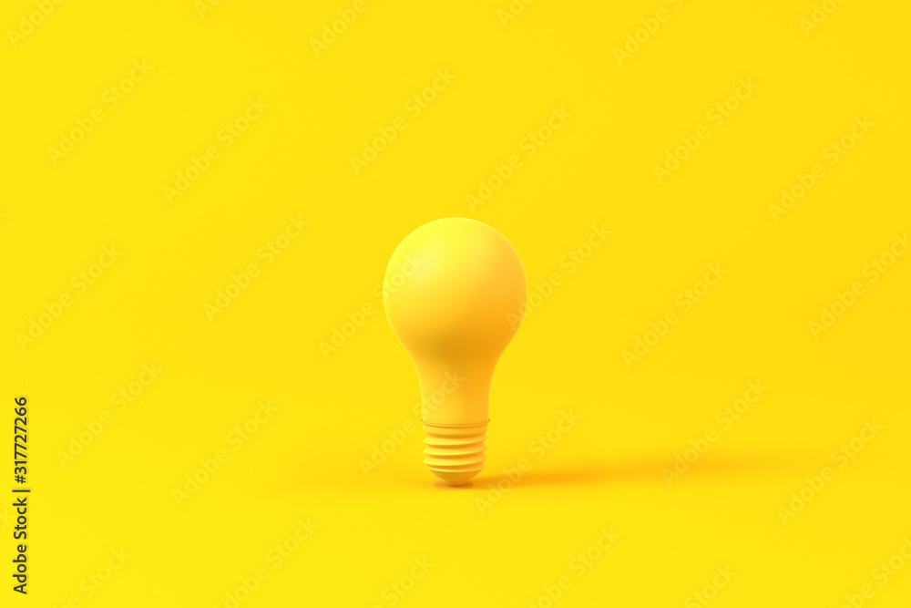 Fototapeta Light bulb isolated over a yellow background. Minimalist concept.