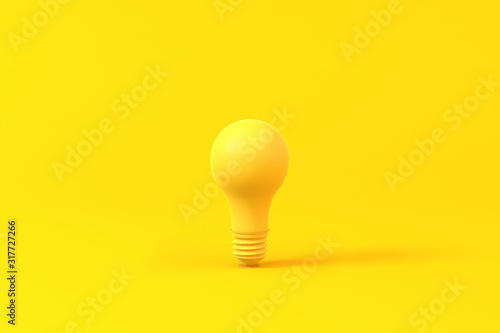 Obraz na plátně Light bulb isolated over a yellow background. Minimalist concept.