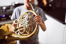 Caucasian Boy Learns To Play Horns, Light Window