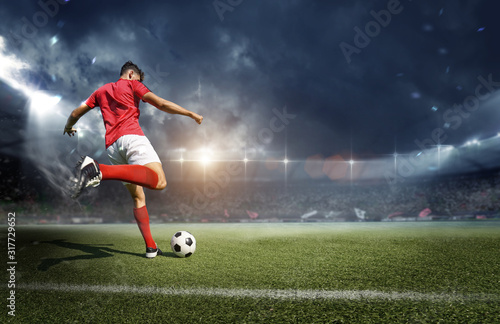 Football player in the stadium Tablou Canvas