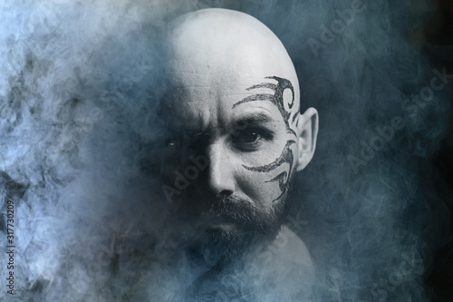 tattoo on the face,  male portrait in the form of an assassin, cosplay,  tattooe Wallpaper Mural