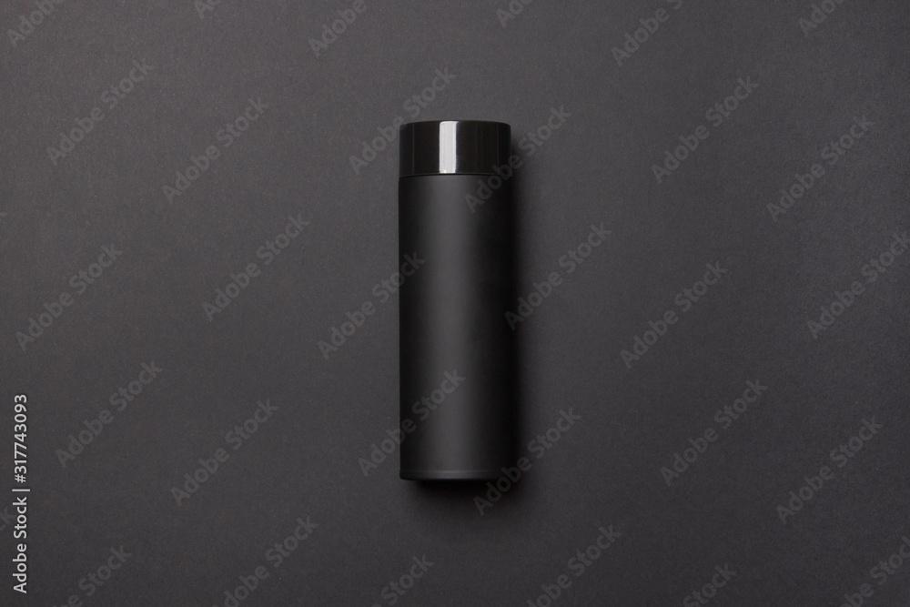 Fototapeta black thermos cup on black background
