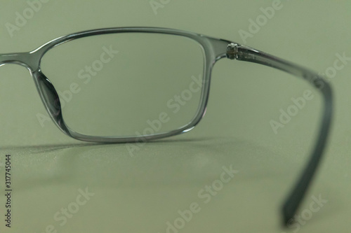 clear plastic glasses, eyes closed, shot close-up, on a blurred green background Canvas Print