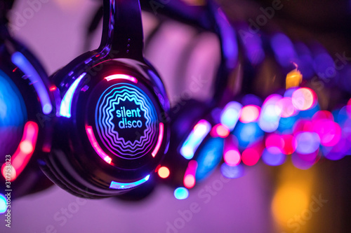 Colorful Silent Disco Headphones at an event - 317753823