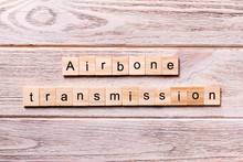Airborne Transmission Word Written On Wood Block. Airborne Transmission Text On Wooden Table For Your Desing, Coronavirus Concept Top View