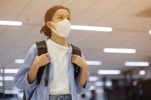 Asian travelers girl with medical face mask to protection the coronavirus in air Wallpaper Mural