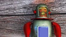 Vintage Tin Robot Toy Isolated...