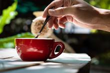 Close Up Of Man Hand Mix Coffe...