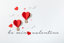 Top View Of Paper Heart Shaped Air Balloons In Clouds Near Be Mine Valentine Lettering On White Background
