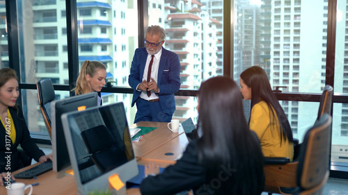 Fototapety, obrazy: Senior employee discussing with business woman at workplace
