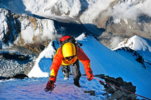 Climber Ascending The Summit O...