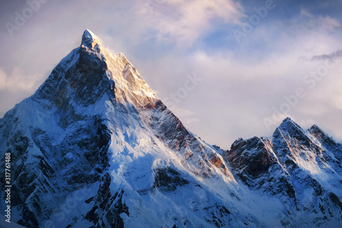 Obraz Panoramic view of beautiful snowy Masherbrum peak in Karakoram mountain range during sunset light - fototapety do salonu