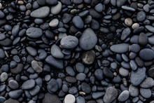View Of Black Sand And Black Stones On A Beach In Iceland
